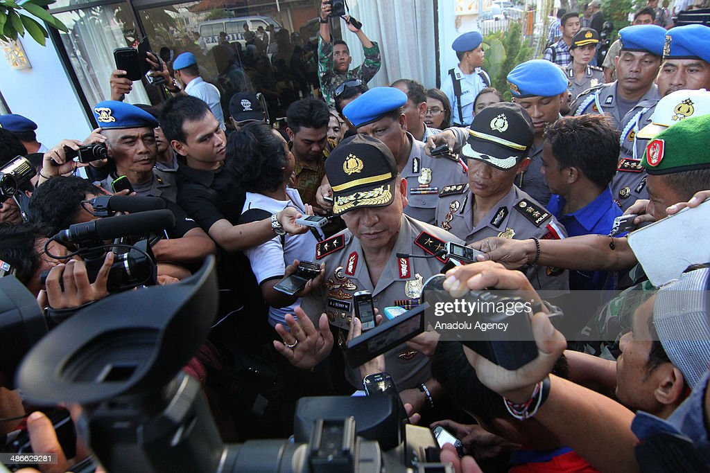 Bali Police Chief Inspector Beni Mokalu answer journalist questions after Virgin Australia plane lands at International Ngurah Rai Airport on April 25, 2014 in Bali, Indonesia. An Indonesian airport went on alert Friday as the air force announced that a plane approaching Ngurah Rai International in Bali had been hijacked in midair. Airline official Heru Sudjatmiko announced minutes later that an intoxicated passenger on the Virgin Australia flight from Brisbane had been arrested for creating a disturbance.