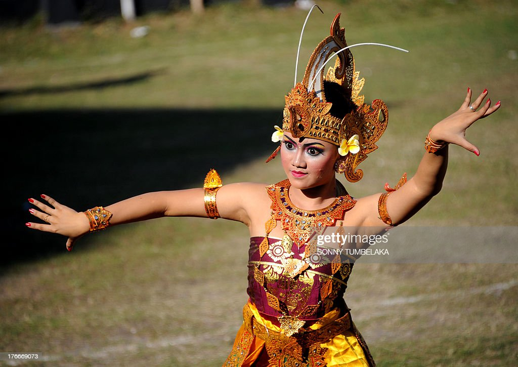 A Balinese dancer participates in official ceremonies and games marking Indonesia's 68th Independence Day at Kerobokan prison in Denpasar on Indonesia's resort island of Bali on August 17, 2013. Indonesia officials annually offer remissions to some prison sentences on the country's Independence Day for good behaviour. Bali's notorious Kerobokan prison is well known as the place holding several foreign inmates held for high-profile drugs offences.