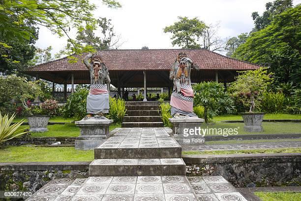 KARANGASEM BALI INDONESIA DECEMBER 23 Balinese figures at the Taman Tirta Gangga Water Palace on December 23 2016 in Karangasem Bali Indonesia