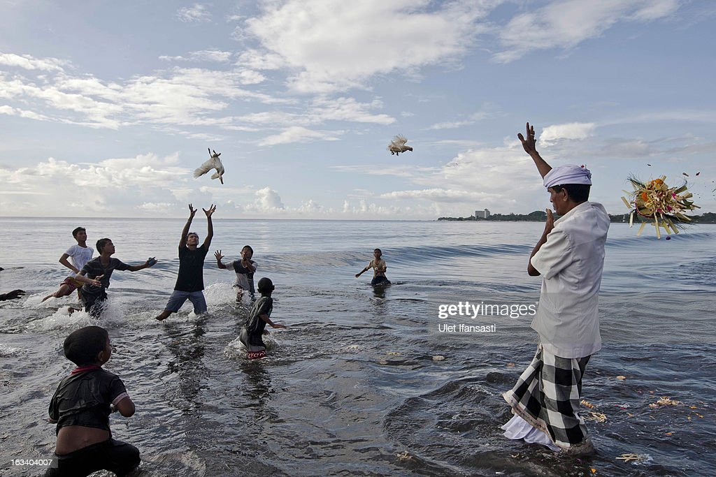 A Balinese Hindu devotee throws ducks into the sea as offerings to gods during the Melasti ritual on March 9, 2013 in Denpasar, Bali, Indonesia. The Melasti ritual is held annually ahead of the Nyepi Day of Silence, a ceremony intended to cleanse and purify the souls of the Balinese Hindu participants. Nyepi is a Hindu celebration observed every new year according to the Balinese calendar. The national holiday is one of self-reflection and meditation and activities such as working, watching television or travelling are restricted between the hours of 6 a.m. and 6 p.m.