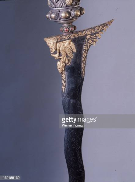 Balinese men regarded the kris as the main symbol of their social identity an heirloom that embodied part of the family deity and had itself vital...