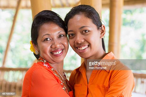 Balinese mother and daughter hugging