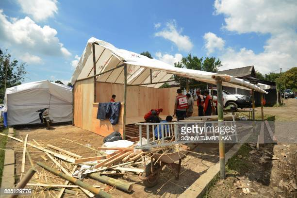 Balinese people build a camp at an evacuation center after being evacuated from Mount Agung volcano at Rendang in Karangasem Regency on Indonesia's...