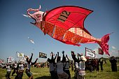 Balinese people fly their giant fish kite during a kite festival in Denpasar on Indonesia's resort island of Bali on July 23 2016 The Bali kite...