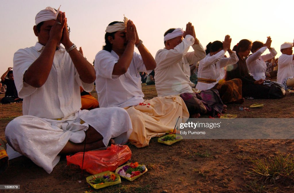 Balinese residents pray during a memorial service for the victims of the bombing in a nightclub October 21, 2002 in Renon, Bali, Indonesia. The blast occurred in the popular tourist area of Kuta October 12, leaving more than 180 people dead and 132 injured, mostly tourists.