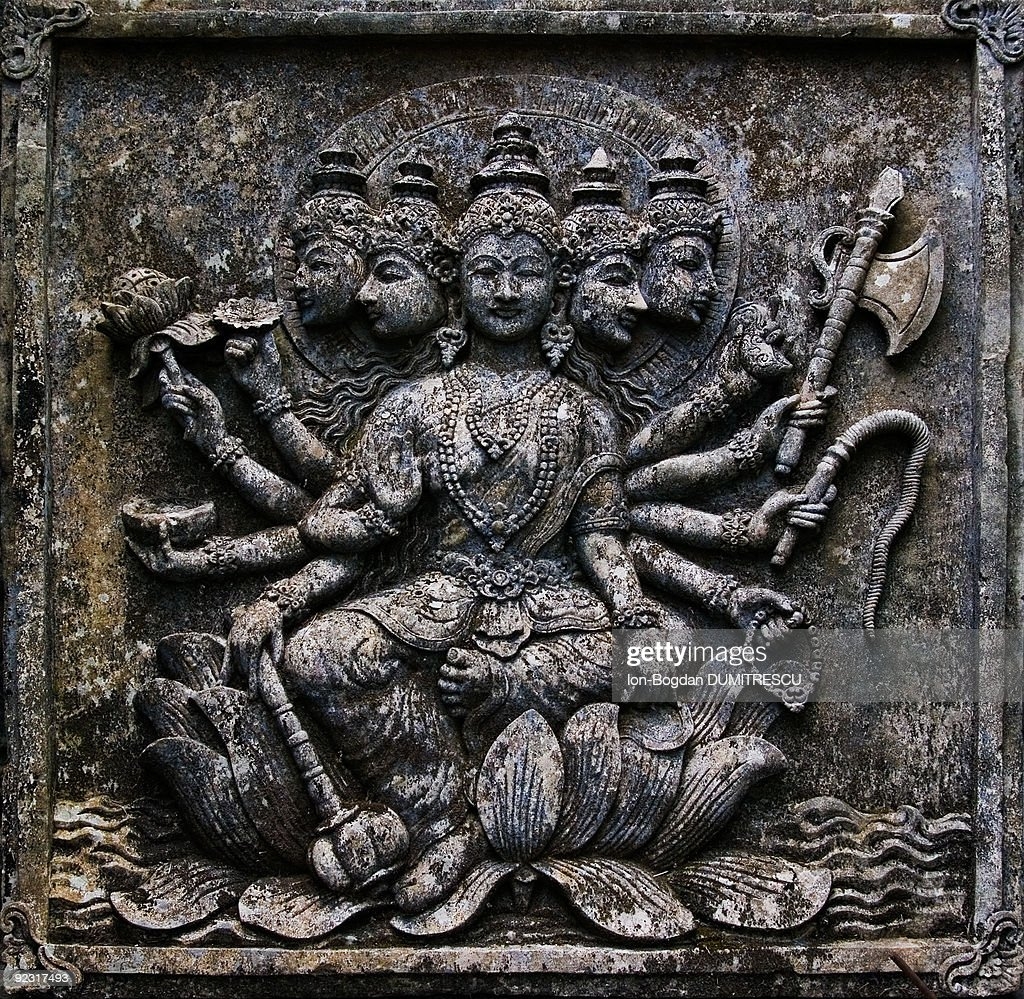 Balinese stone carving stock photo getty images