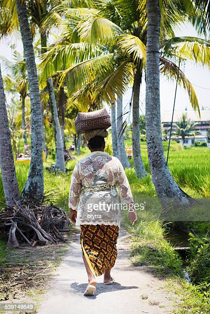 Balinese woman carrying a basket on her head