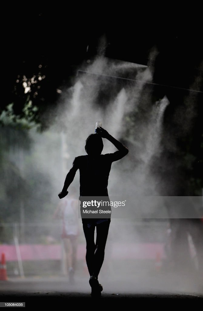 Baljinder Singh of India drinks some water as he competes in the men's 20km walk around the city during day six of the Delhi 2010 Commonwealth Games on October 9, 2010 in Delhi, India.