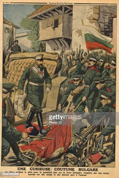 Ferdinand I of Bulgaria according to the custom of his country walking on on the weapons and flags of enemies conquered by his army in this case the...