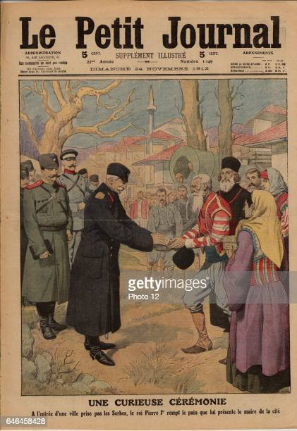 Peter I King of Serbia performing the traditional ceremony of breaking the bread offered to him by the Mayor of a town captured by Serbian troops...