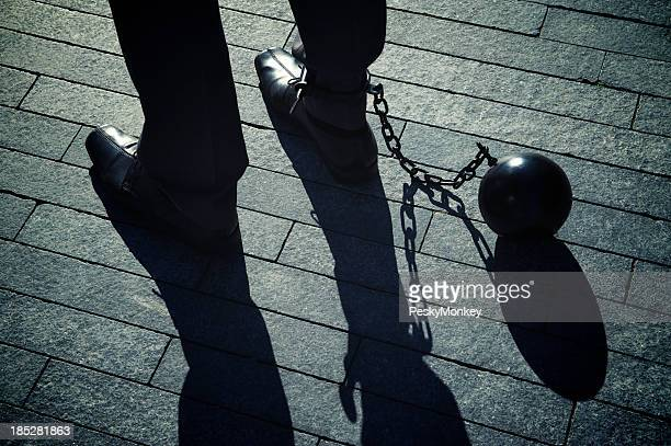 Ball and Chain Businessman with Long Shadows