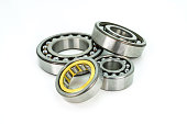 Ball bearing lying on a white background with clipping path.