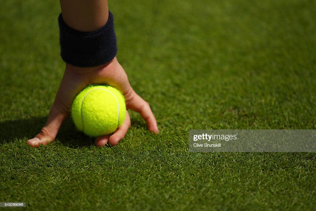 A ball boy holds a ball on day one of the Wimbledon Lawn Tennis Championships at the All England Lawn Tennis and Croquet Club on June 27th, 2016 in London, England.