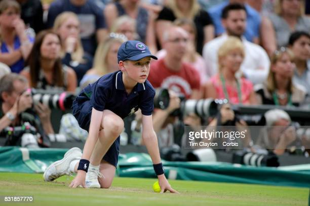 A ball boy in action on Center Court during the Wimbledon Lawn Tennis Championships at the All England Lawn Tennis and Croquet Club at Wimbledon on...