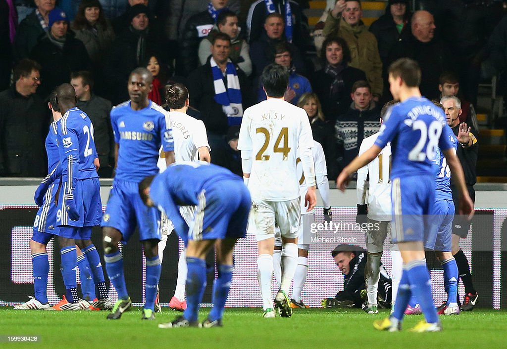 A ball boy lays on the ground after being kicked by <a gi-track='captionPersonalityLinkClicked' href=/galleries/search?phrase=Eden+Hazard&family=editorial&specificpeople=5539543 ng-click='$event.stopPropagation()'>Eden Hazard</a> of Chelsea who is then sent off during the Capital One Cup Semi-Final Second Leg match between Swansea City and Chelsea at Liberty Stadium on January 23, 2013 in Swansea, Wales.