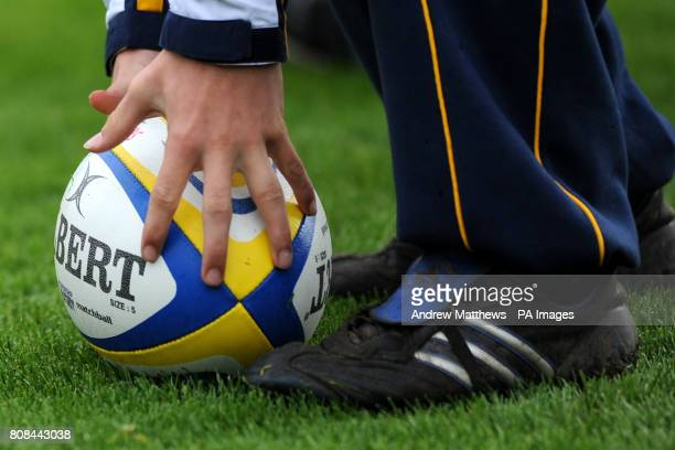 A ball boy picks up an Aviva branded Gilbert matchball