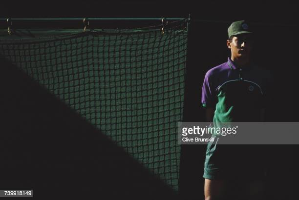 A ball boy stands in the shadows of a match during the Wimbledon Lawn Tennis Championships on 27 June 1995 at the All England Lawn Tennis and Croquet...