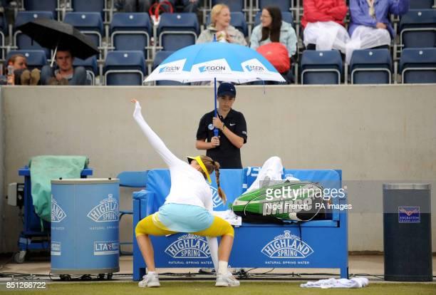 A ball boy watches Daniela Hantuchova go through a warm up routine during a rain break in her semi final against Alison Riske during the AEGON...