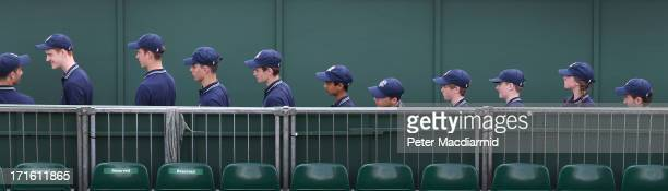 Ball boys and ball girls line up to enter a court on day four of the Wimbledon Lawn Tennis Championships at the All England Lawn Tennis and Croquet...