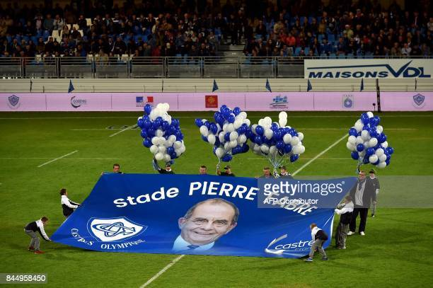 Ball boys hold a banner for the stadium's new name ahead of the French L1 football match between Troyes and Toulouse on September 9 at the Aube...