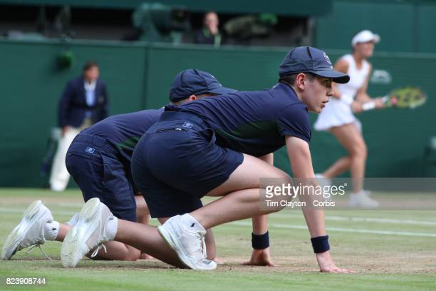 Ball boy's in action on Center Court during the Wimbledon Lawn Tennis Championships at the All England Lawn Tennis and Croquet Club at Wimbledon on...