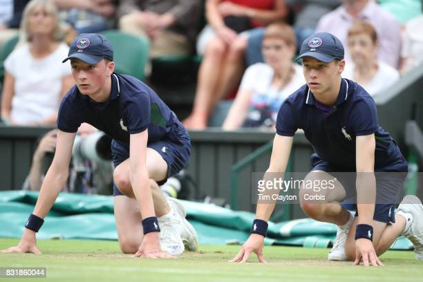 Ball boys' in action on Center Court during the Wimbledon Lawn Tennis Championships at the All England Lawn Tennis and Croquet Club at Wimbledon on...