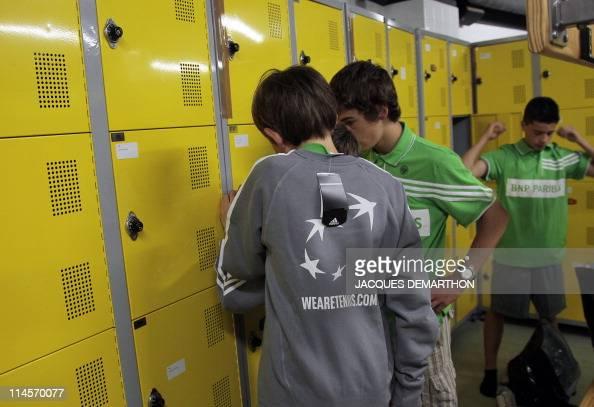 Young Boys Changing In Locker Room Stock-Fotos und Bilder