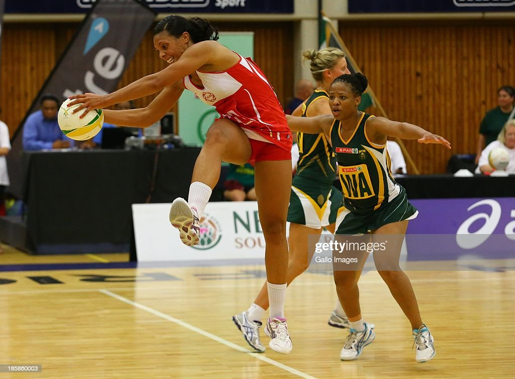 ball carrier Stacey Francis of England and Simnikiwe Mdaka of South Africa during the International SPAR Tri Nations netball final match between South Africa and England at Vodacom NMMU Indoor Stadium on October 25, 2013 in Port Elizabeth, South Africa.