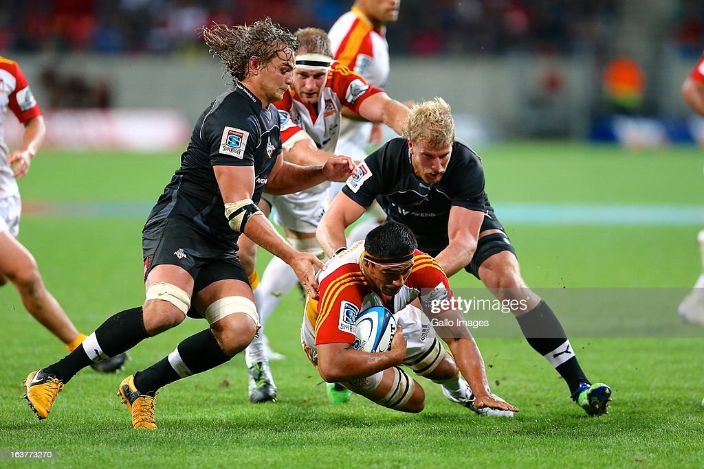 Ball carrier Tanerau Latimer of the Chiefs, Wimpie van der Walt of the Southern Kings and Jacques Engelbrecht of the Southern Kings during the Super Rugby match between Southern Kings and Chiefs from Nelson Mandela Bay Stadium on March 15, 2013 in Port Elizabeth, South Africa