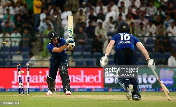 A ball delivered by Pakistan's Wahab Riaz hits the stumps to dismiss England's Jos Buttler as his teammate Eoin Morgan looks on during the second One...