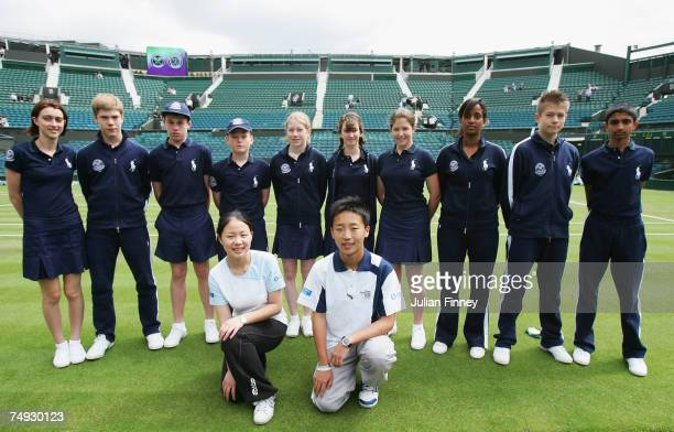 A ball girl and boy invited from Shanghai in China pose with Wimbledon counterparts before participating in the event during day three of the...