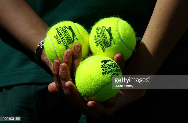 A ball girl holds tennis balls during qualifying for Wimbledon 2010 Tennis at Roehampton on June 15 2010 in London England