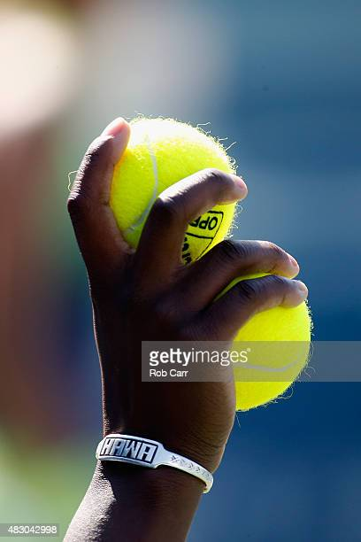 A ball girl holds up tennis balls during a singles match at Rock Creek Tennis Center on August 5 2015 in Washington DC