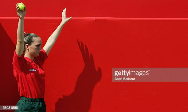A ball girl waits for another ball during his first round match between Xavier Malisse of Belgium and Lleyton Hewitt of Australia at the Stella...