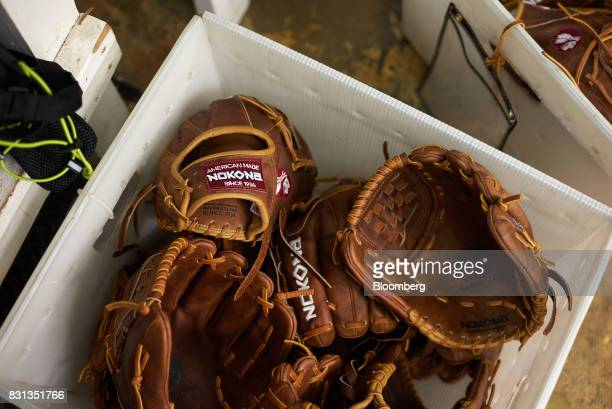 Ball gloves sit in a bin at the Nokona manufacturing facility in Nocona Texas US on Thursday July 27 2017 Since the Great Depression Nokona has been...