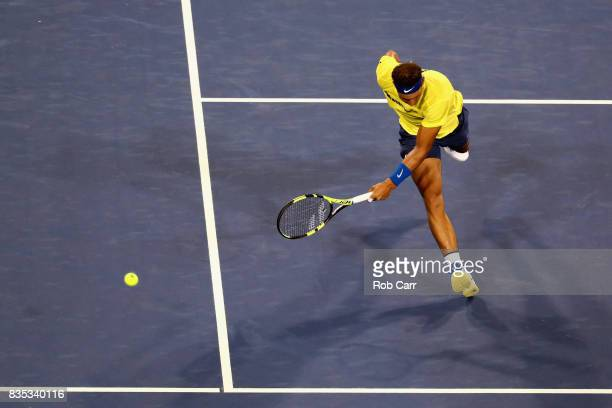 A ball hit by Nick Kyrgios of Australia goes past Rafael Nadal of Spain during Day 7 of the Western and Southern Open at the Linder Family Tennis...