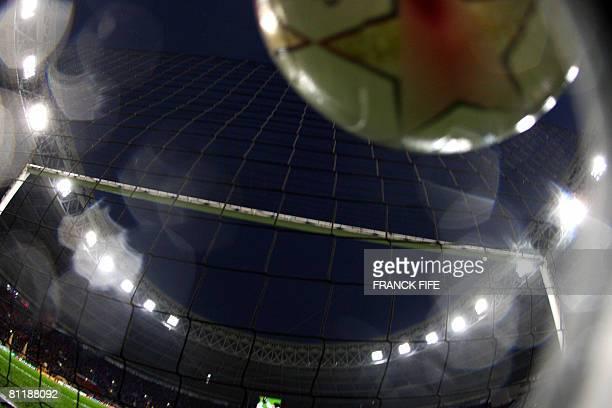 A ball hits the back of the net as Manchester United warm up prior to the final of the UEFA Champions League football match against Chelsea at the...