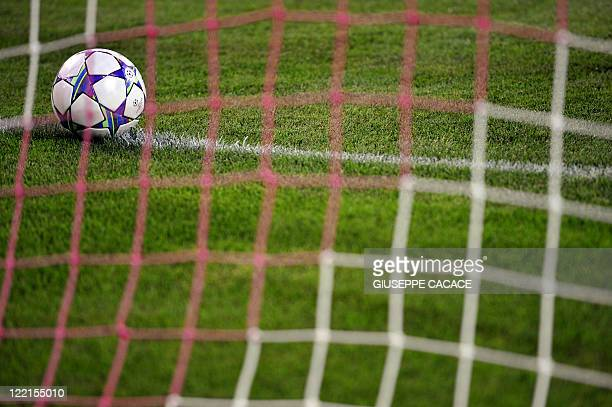 A ball is pictured through the goal net at the Udine's stadium in Udine on August 24 2011 prior to the start of the Champion league match Udinese vs...