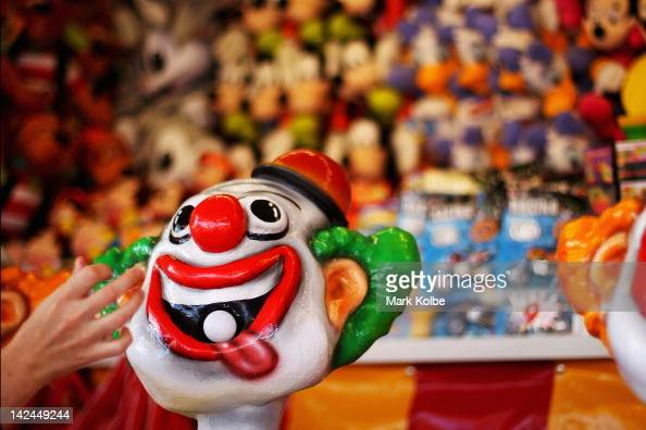 A ball is placed in the mouth of a crazy laughing clown in the carnival area during the 2012 Sydney Royal Easter Show at the Sydney Showground on...