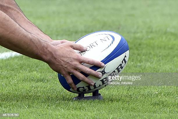 A ball is placed on a kicking tee during the French Top 14 rugby union match Toulouse against Castres on September 5 2015 at the Ernest Wallon...