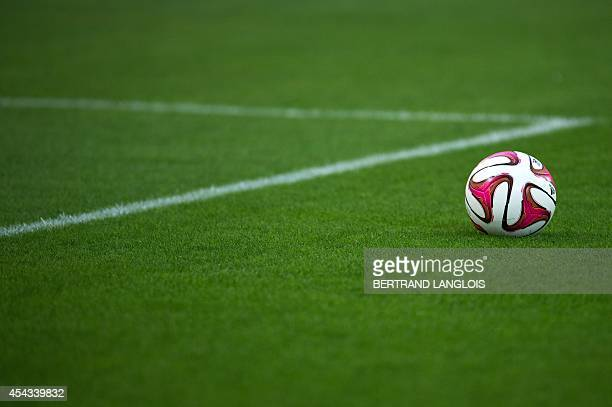 A ball is seen on the pitch prior to the French L1 football match Olympique de Marseille vs OGC Nice on August 29 2014 at the Velodrome stadium in...