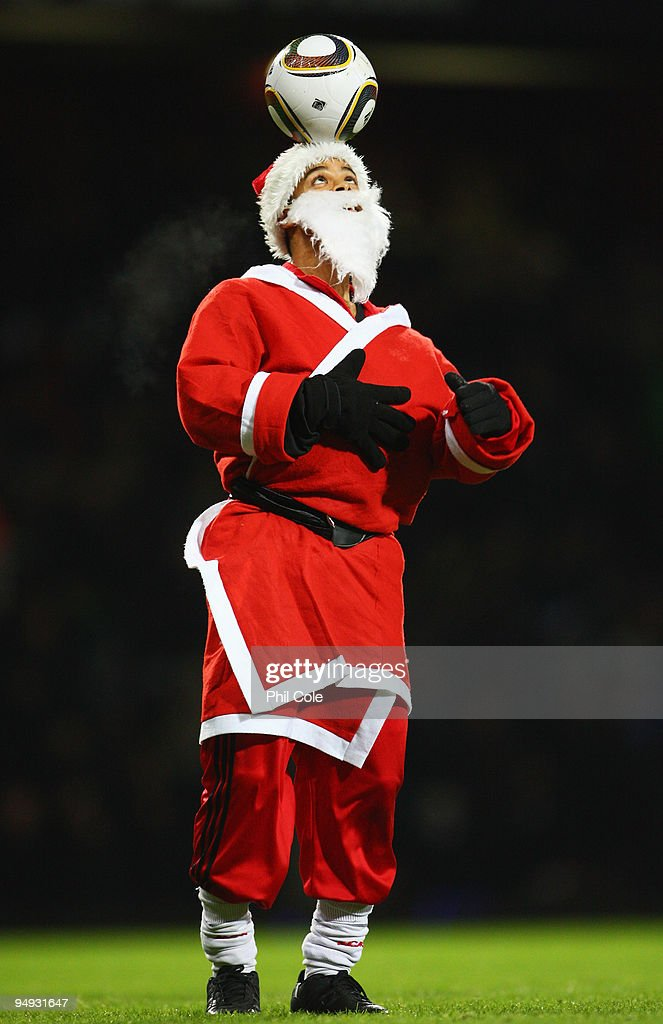 A ball juggler dressed as Father Christmas displays his skills at half time during the Barclays Premier League match between West Ham United and Chelsea at Upton Park on December 20, 2009 in London, England.