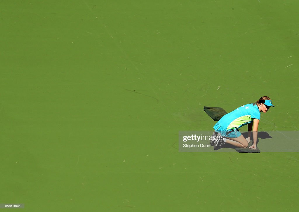 A ball kid tends her position on Stadium Court One during day 6 of the BNP Paribas Open at Indian Wells Tennis Garden on March 11, 2013 in Indian Wells, California. (Photo by Stephen Dunn/Getty Images).