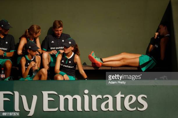 Ball Kids take a break on day five of the 2017 French Open at Roland Garros on June 1 2017 in Paris France