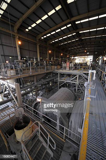 A ball mill center grinds copper ore at the processing plant of Rio Tinto Group's Northparkes copper and gold underground block cave mine in Parkes...