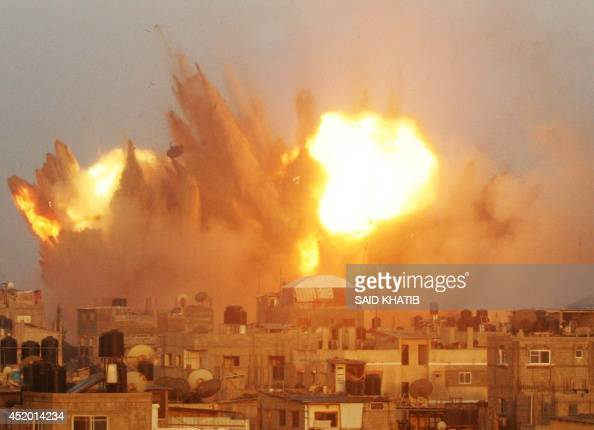 RECROP== A ball of fire is seen following an early morning Israeli air strike on July 11 on Rafah in the southern of Gaza strip Israeli warplanes...