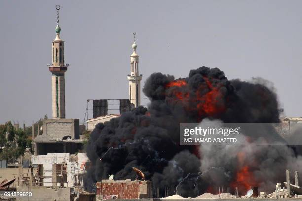 A ball of fire rises from a building following a reported air strike by Syrian government forces on a rebelheld area in the southern city of Daraa on...