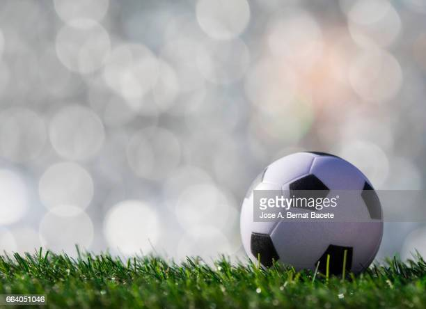 Ball of  soccer ball  on a surface of  grass of a soccer field