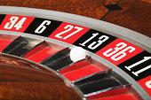 Ball on number thirteen on roulette wheel