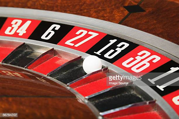 Ball on number thirteen on roulette wheel